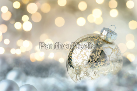shiny christmas bauble and glittering lights