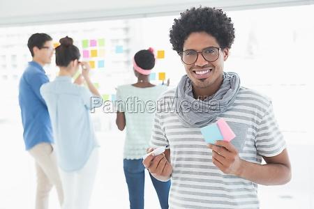 young creative man smiling at camera