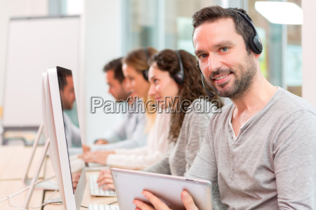 young attractive man working in a