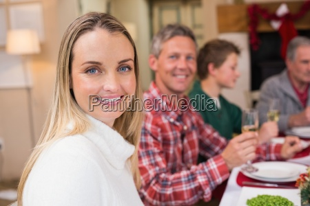 woman smiling at camera during christmas