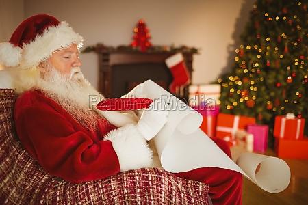 santa claus writing his list on