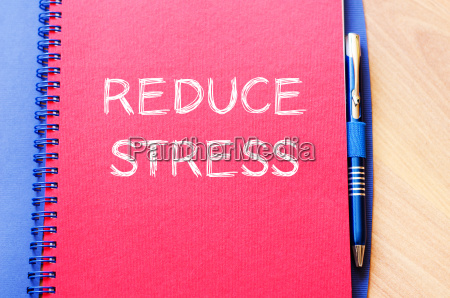 reduce stress write on notebook