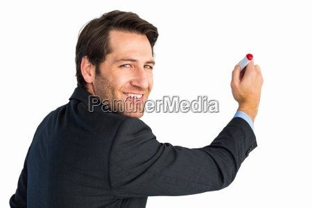 businessman standing and writing while looking