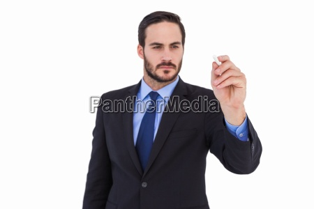 businessman holding a chalk and writing