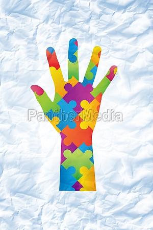 composite image of autism awareness hand
