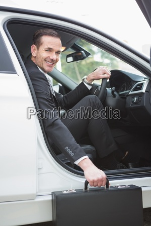 businessman getting out the front door