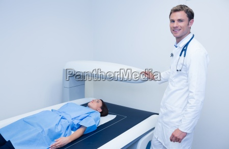 smiling doctor doing a radiography on