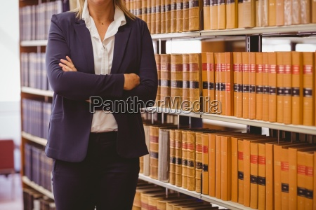 mature female librarian posing with crossed