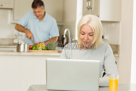 happy mature blonde using laptop