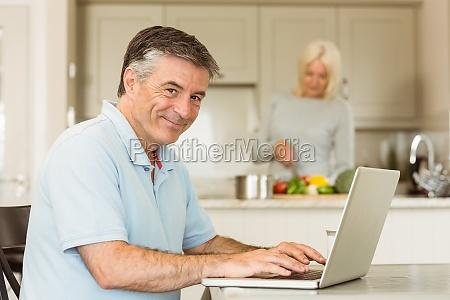 happy mature man using laptop