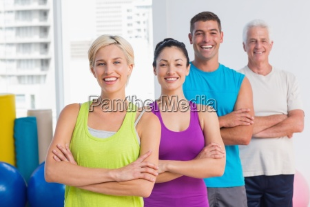 fit people standing arms crossed at