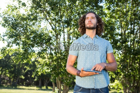 young man using tablet in the