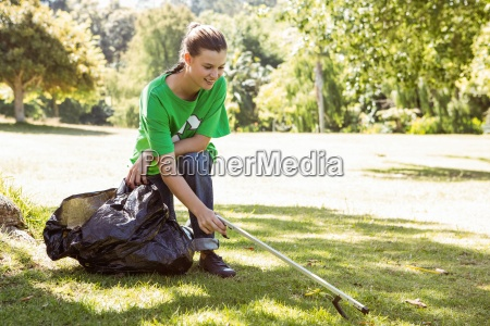 environmental activist picking up trash