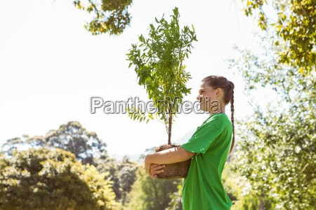environmental activist about to plant tree