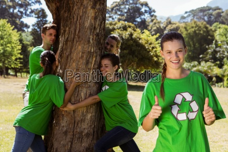 environmental activists hugging a tree in