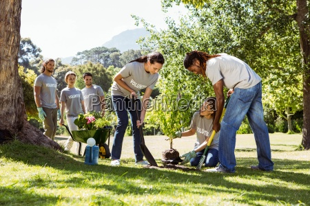 team of volunteers gardening together