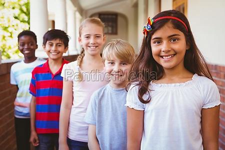 smiling little school kids in school