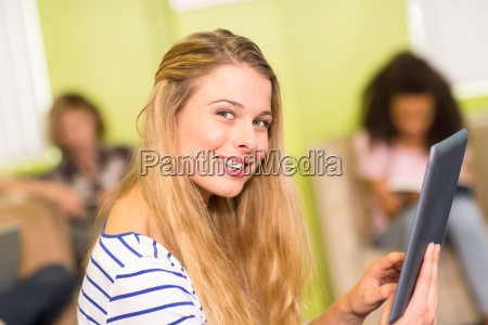casual young woman using digital tablet