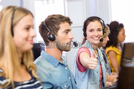 students using headsets in computer class
