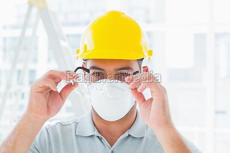 handyman wearing protective eyewear at site