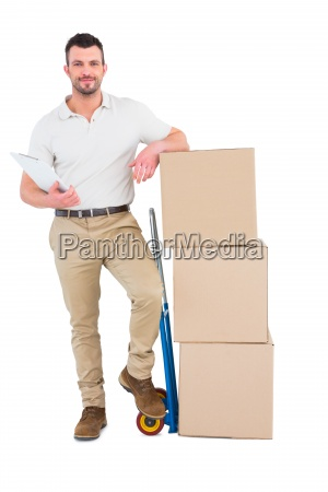 confident delivery man with cardboard boxes