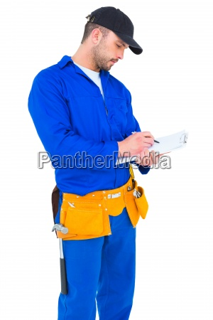 handyman in blue overall writing on