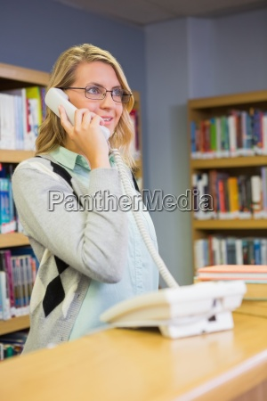 pretty librarian answering the phone