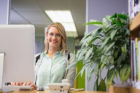 pretty librarian smiling at camera