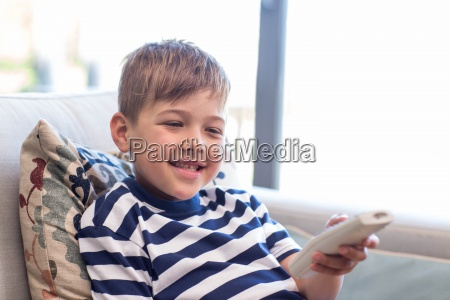 little boy watching tv on the