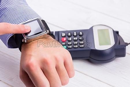 man using smart watch to express