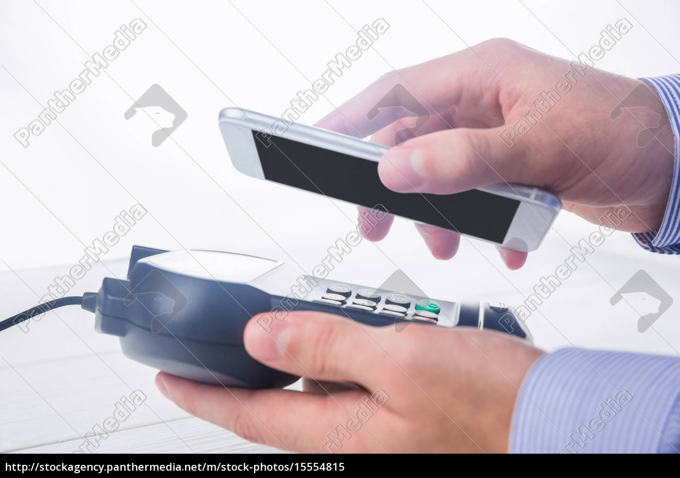 man, using, smartphone, to, express, pay - 15554815