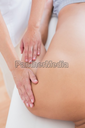 physiotherapist doing arm massage to her