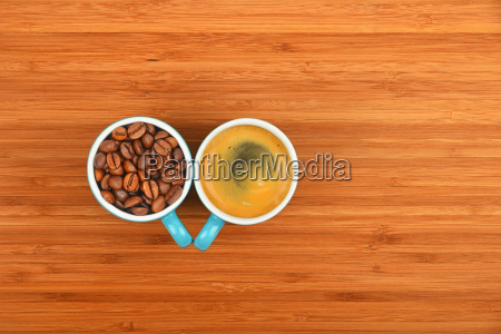two coffee cups espresso and beans