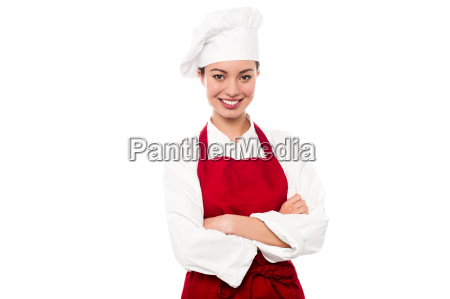 beautiful smiling chef posing over white