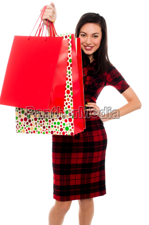 attractive young lady with shopping bags