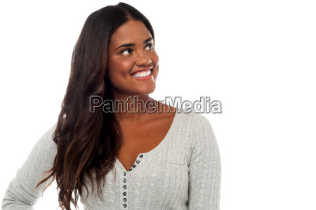 smiling young woman looking away