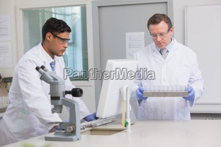 scientists working together on tubes and