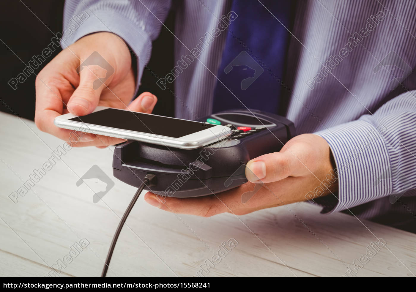 man, using, smartphone, to, express, pay - 15568241