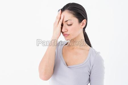 sad woman hiding her face