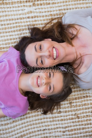 mother and daughter smiling at camera