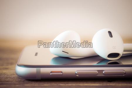 closeup modern headphone on phone media