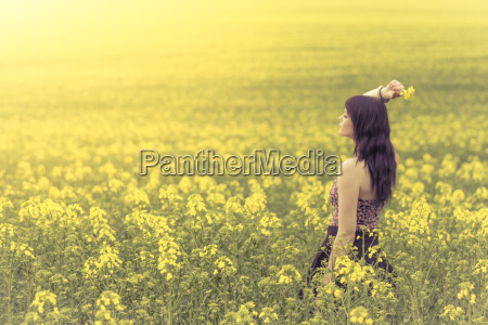 beautiful woman in meadow of yellow
