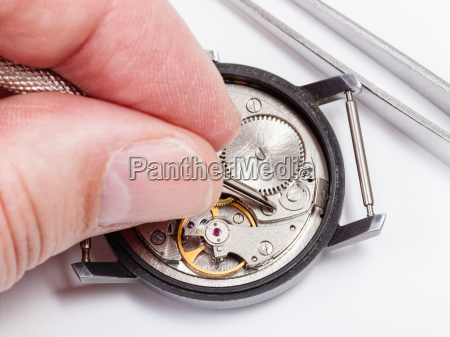 watchmaker repairs old watch close up