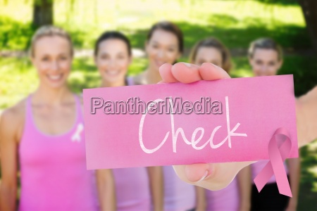 check against smiling women in pink