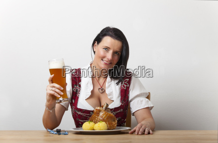 bavarian woman with fried pork knuckle