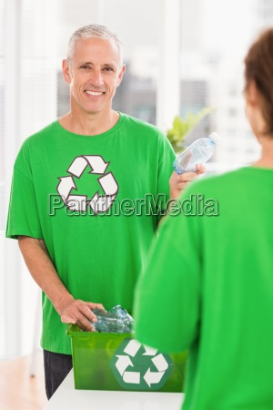 smiling eco minded man holding recycling