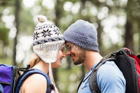 young happy hiker couple touching foreheads