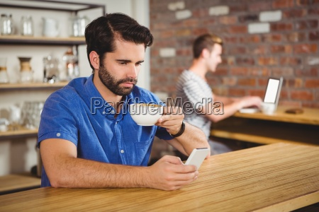young man enjoying a coffee and