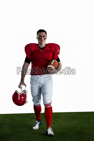 portrait of american football player walking