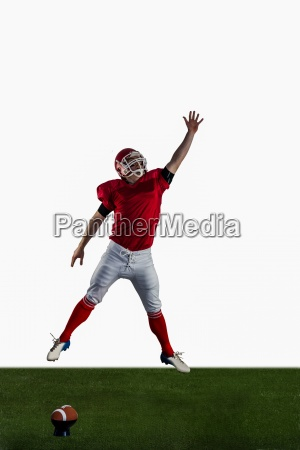 american football player trying to catch